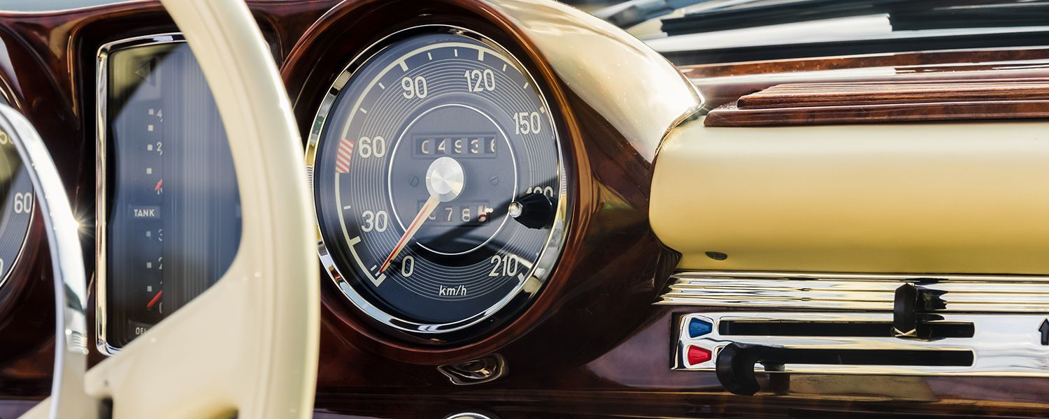 Classic vehicles: Close-up of the speedometer in a classic car.