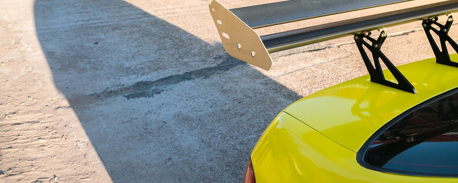 Modified vehicles: Close-up of a yellow car with a modified bumper.