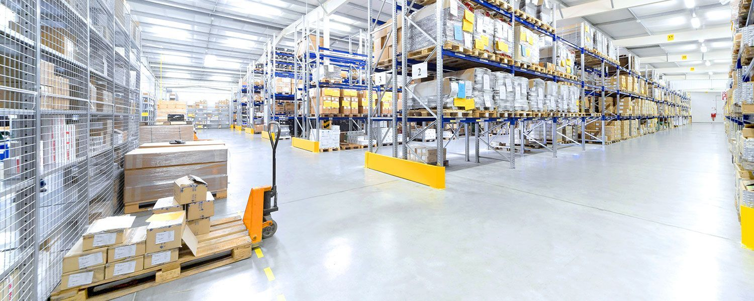 Warehouse insurance: The inside of a vast and empty warehouse.