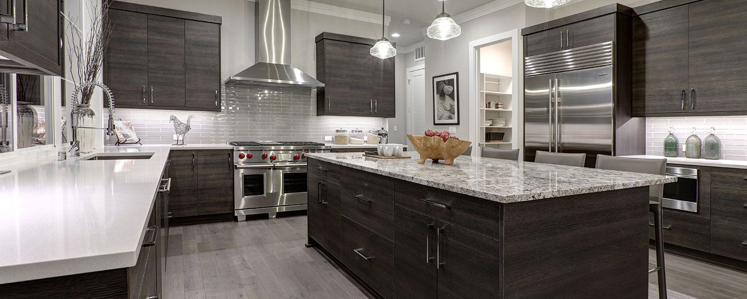 Kitchen and bathroom showroom insurance: Inside of a silver and darkbrown kitchen.